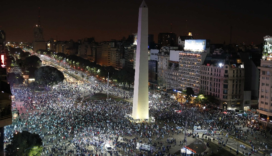 """Argentina's fans gather around the Obelisk after Argentina lost to Germany in their 2014 World Cup final soccer match in Brazil, at a public square viewing area in Buenos Aires"""